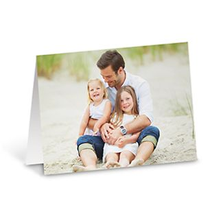 Smiling dad with children on photo card